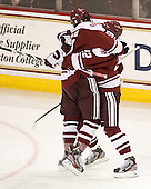 Steven Guzzo (UMass - 9) and Michael Marcou (UMass - 22) celebrate a UMass goal that was award to Danny Hobbs. - The Boston College Eagles defeated the visiting University of Massachusetts-Amherst Minutemen 2-1 in the opening game of their 2012 Hockey East quarterfinal matchup on Friday, March 9, 2012, at Kelley Rink at Conte Forum in Chestnut Hill, Massachusetts.