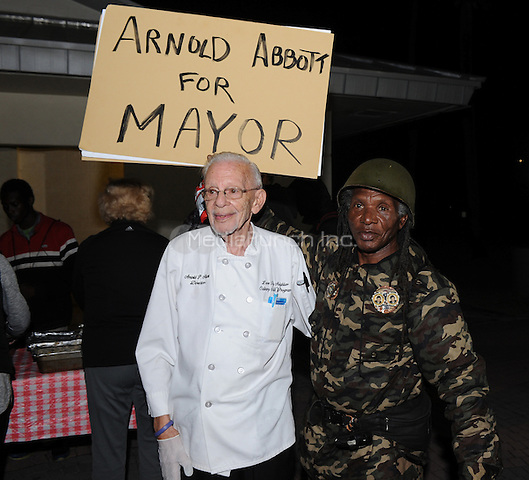 FORT LAUDERDALE, FL - NOVEMBER 19: Arnold Abbott, a 90-year-old chef, serves food to the homeless in violation of a recently passed city law on November 19, 2014 in Fort Lauderdale, Florida. The city said they passed the ordinance which tightens restrictions on outdoor feedings in public spaces for sanitary and security reason, but Mr. Abbott continued to feed the homeless in a city park where he has twice been cited for violating the new ordinance. Credit: mpi04/MediaPunch