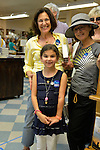 "Huntington, New York, U.S. - August 6, 2014 - A young girl, her mother and another woman are wearing buttons saying ""I'm ready for Hillary"" as the three wait on line inside the Book Revue at the book signing for the H. Clinton new memoir, Hard Choices, in Huntington."