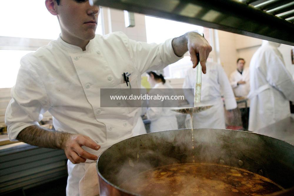Students cook during a class at the Ecole Superieure de Cuisine Francaise Gregoire Ferrandi cooking school in Paris, France, 18 December 2007.