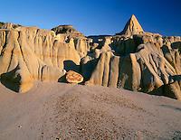 "NDTR_106 - USA, North Dakota, Theodore Roosevelt National Park, Pedestals or rain pillars consist of hard sandstone slabs called ""caprocks"" atop softer, eroded clay sediments, South Unit."