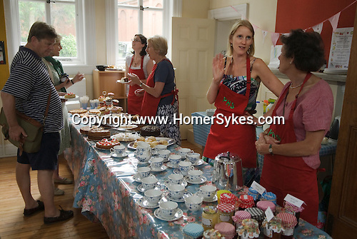 Petersham Village Richmond Surrey annual fete and flower show.  Tea and cake being served.