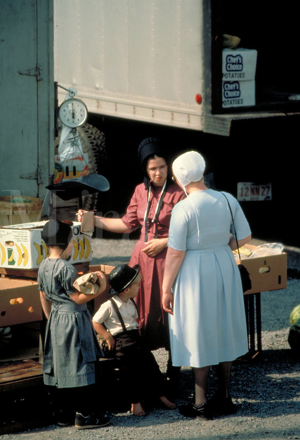 Amish women buy and sell produce at a country outdoor market. Amish women. Kidron Ohio United States Market.