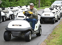 NWA Democrat-Gazette/FLIP PUTTHOFF <br />GOLF COURSE RIDES<br />Mike Denny with Clear Creek Golf Car in Rogers lines up golf carts Wednesday May 3 2017 at the Bella Vista Country Club golf course. Od carts at the course were traded for new ones, said Denny, who helped load the used carts on to a truck as new ones arrived.