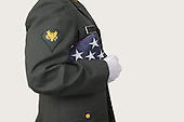 Soldier holding a folded flag stock photo