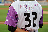 """The back of Akron RubberDucks Jonathan Lopez (32) jersey before an Eastern League game against the Erie SeaWolves on August 30, 2019 at Canal Park in Akron, Ohio.  Akron wore special jerseys with the slogan """"Fight Like a Kid"""" during the game for Akron Children's Hospital Home Run for Life event, the design was created by 11 year old Macy Carmichael.  Erie defeated Akron 3-2.  (Mike Janes/Four Seam Images)"""