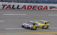 Oct. 30, 2009; Talladega, AL, USA; NASCAR Sprint Cup Series driver Jimmie Johnson (48) leads Carl Edwards (99) during practice for the Amp Energy 500 at the Talladega Superspeedway. Mandatory Credit: Mark J. Rebilas-