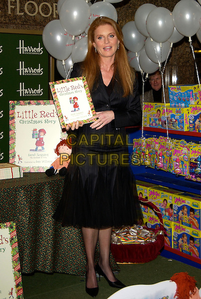 "SARAH FERGUSON, Duchess of York.Signs copies of her new book ""Little Red's Christmas Story"" ,Harrods , London 28  October 2004..full length pinstripe suit skirt .Ref: PL.www.capitalpictures.com.sales@capitalpictures.com.©Capital Pictures.."