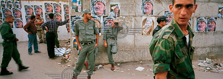 Palestinian officers on guard at one of the entrances to the Muqata compound, the Palestinian Authority's headquarters, on the day the death of Yasser Arafat was declared.