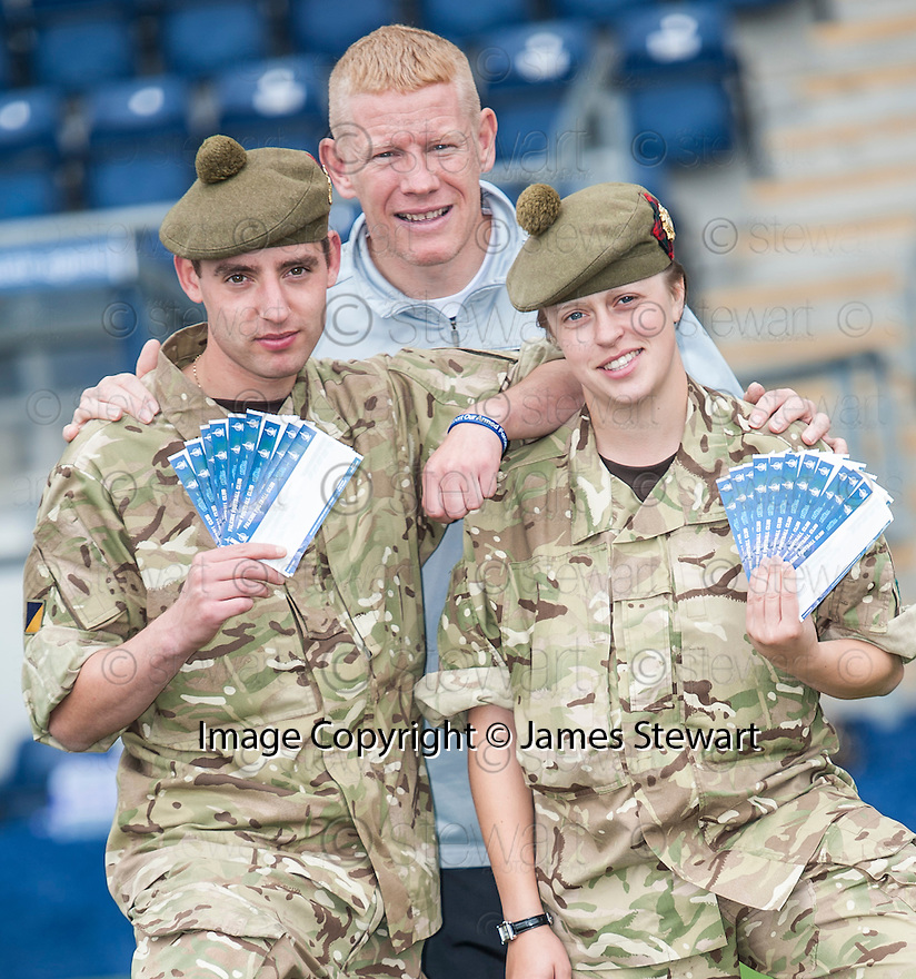 Private Michael Dougall and Private Jennifer Rankin from the Scottish Transport Regiment help Falkirk manager Gary Holt launch the Tickets for Troops giveaway.