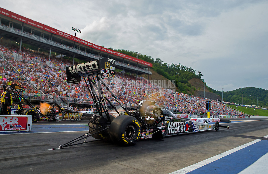 Jun 19, 2015; Bristol, TN, USA; NHRA top fuel driver Antron Brown (right) races alongside teammate Tony Schumacher during qualifying for the Thunder Valley Nationals at Bristol Dragway. Mandatory Credit: Mark J. Rebilas-USA TODAY Sports