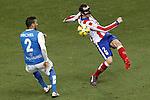 Atletico de Madrid's Diego Godin (r) and UD Almeria's Michel Macedo during La Liga match.February 21,2015. (ALTERPHOTOS/Acero)