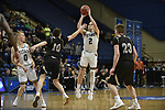 SALEM, VA - MARCH 17: Wisconsin-Oshkosh Titans guard Ben Boots (2) shoots past Nebraska Wesleyan Prairie Wolves guard Nate Schimonitz (10) and Nebraska Wesleyan Prairie Wolves forward Ryan Garver (23) during the Division III Men's Basketball Championship held at the Salem Civic Center on March 17, 2018 in Salem, Virginia. Nebraska Wesleyen defeated Wisconsin-Oshkosh 78-72 for the national title. (Photo by Andres Alonso/NCAA Photos/NCAA Photos via Getty Images)