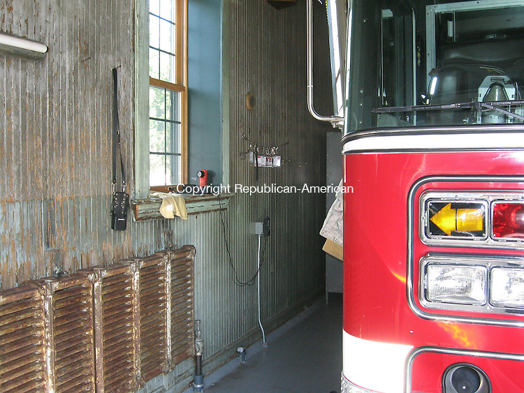 WATERBURY, CT - 19 SEPT. 2008 - 091908PO1 - The city will begin an $809,000 renovation of the Baldwin Street fire house in October to address multiple fire code violations, including old oak wainscoting on the truck bay walls and ceilings.