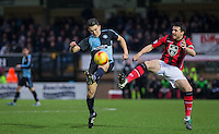 Luke O'Nien of Wycombe Wanderers & Peter Murphy of Morecambe go in for the ball during the Sky Bet League 2 match between Wycombe Wanderers and Morecambe at Adams Park, High Wycombe, England on 2 January 2016. Photo by Andy Rowland / PRiME Media Images
