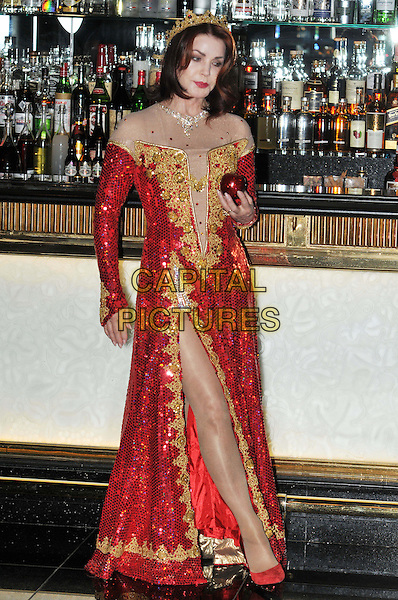 Priscilla Presley.Press launch to star in New Wimbledon Theatre's annual pantomime offering 'Snow White and the Seven Dwarfs' at The Savoy, Strand, London, England..September 26th, 2012.panto costume full length gold red dress crown sequins sequined slit split  apple  .CAP/BF.©Bob Fidgeon/Capital Pictures.
