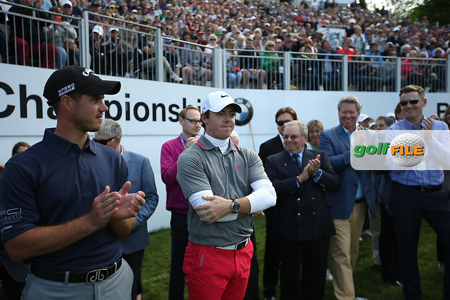 PGA star Mark Hooper stands shoulder to shoulder with the winner Rory McIlroy (NIR) at the BMW PGA Championship from Wentworth Golf Club, Virginia Waters, London, UK. Picture:  David Lloyd / www.golffile.ie