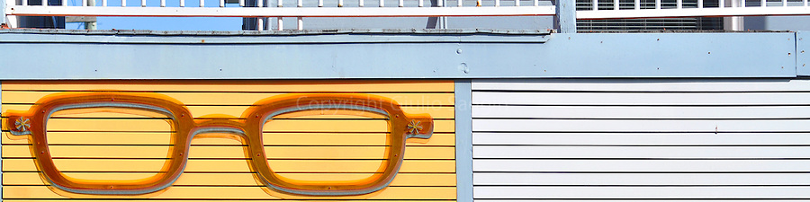 A large pair of glasses, advertising an optometrist's store, sits on the side of a building on James Street in the inner-city Brisbane suburb of Fortitude Valley.