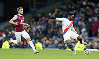 Crystal Palace's Jeffrey Schlupp under pressure from Burnley's Jay Rodriguez<br /> <br /> Photographer Rich Linley/CameraSport<br /> <br /> The Premier League - Burnley v Crystal Palace - Saturday 30th November 2019 - Turf Moor - Burnley<br /> <br /> World Copyright © 2019 CameraSport. All rights reserved. 43 Linden Ave. Countesthorpe. Leicester. England. LE8 5PG - Tel: +44 (0) 116 277 4147 - admin@camerasport.com - www.camerasport.com