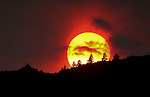 Smoky skies make for a dramatic sunset in Carson City, Nev., on Sunday, Aug. 18, 2013. <br /> Photo by Cathleen Allison