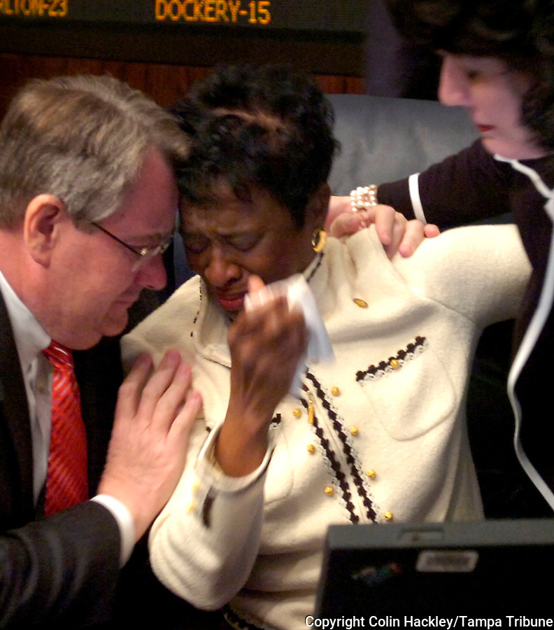 TALLAHASSEE, FL. 3/26/08-Sen. Arthenia Joyner, D-Tampa, center, is consoled by Sens. Don Gaetz, R-Niceville, left, and Sen. Ronda Storms, R-Valrico, right, after the Senate passed a concurrent resolution expressing profound regret for the involuntary servitude of Africans, Wednesday at Capitol in Tallahassee. COLIN HACKLEY PHOTO