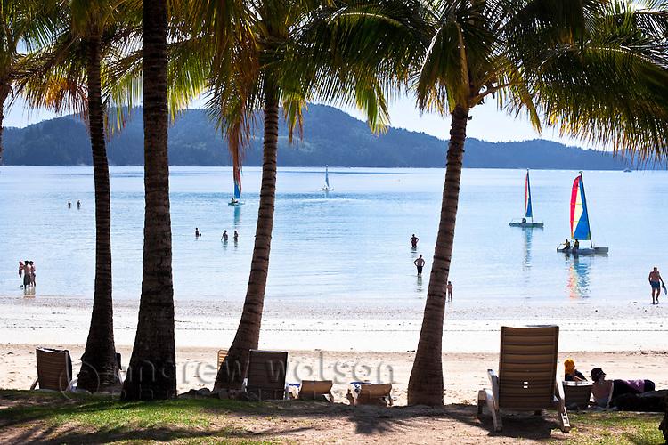 Tourists relaxing at Catseye Beach.  Hamilton Island, Whitsunday Islands, Queensland, Australia