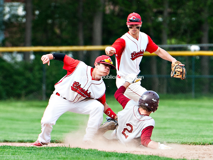 CHESHIRE, CT - 12 May 2014-051214EC05--   Cheshire's Tommy Savino reaches to get Sheehan's Kevin Mathews out at second base. Behind them is Cheshire's Cooper Mrowka. The Rams came from behind to beat Sheehan, 6-4, in Cheshire Monday afternoon. Erin Covey Republican-American.