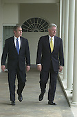 United States President-elect George W. Bush, left, is escorted along the colonnade at the White House in Washington, DC by U.S. President Bill Clinton, right, on December 19, 2000.<br /> Credit: Ron Sachs / Pool via CNP