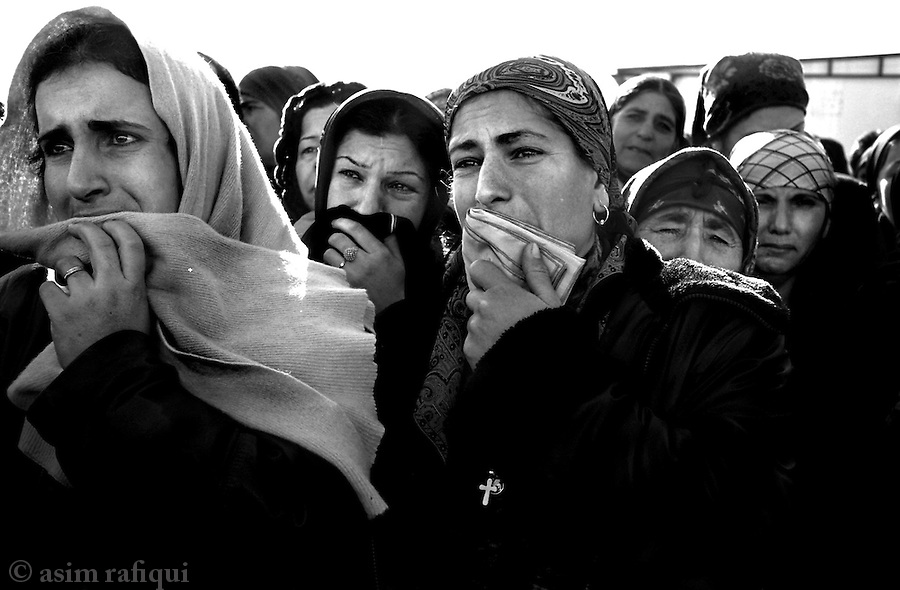 balgani, northern iraq, january 2005: on the 40th day of mourning at khosaba village, women visit the home of sami eshu khoshaba who was killed by islamic insurgents/resistance fighters near the city of mosul<br />