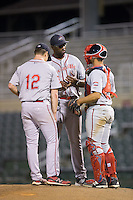 Greenville Drive pitching coach Walter Miranda (44) has a meeting on the mound with relief pitcher Marc Brakeman (12) and catcher Tyler Spoon (15) during the game against the Kannapolis Intimidators at Intimidators Stadium on June 7, 2016 in Kannapolis, North Carolina.  The Drive defeated the Intimidators 5-2 in game two of a double header.  (Brian Westerholt/Four Seam Images)
