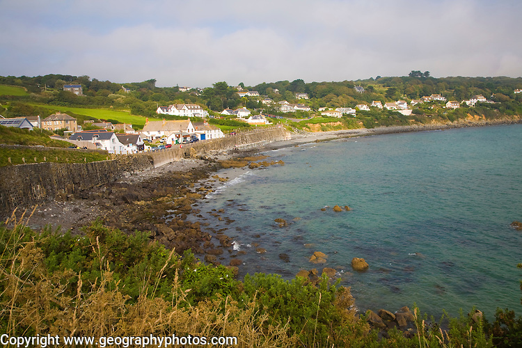 Seaside houses on cliffs overlooking the sea at the village of Coverack on the Lizard peninsula, Cornwall, England