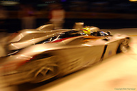 A Cadillac LMP pulls out of the pit box at the 2002 24 Hours of Le Mans.
