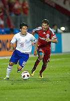 17 August 2010:  Toronto FC midfielder Martin Saric #25 and Cruz Azul Cesar Villaluz #18 in action during a CONCACAF Champions League group stage game between Cruz Azul and Toronto FC at BMO Field in Toronto..Toronto FC won 2-1.....