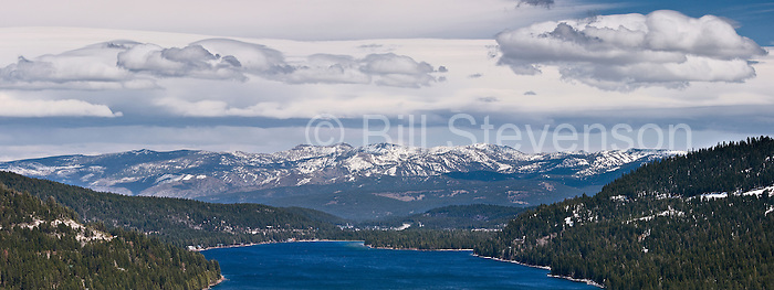 A photo of Donner Lake and the Sierra Mountains on a partly cloudy day in California