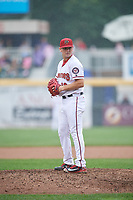 Harrisburg Senators starting pitcher Wil Crowe (18) gets ready to deliver a pitch during a game against the Akron RubberDucks on August 19, 2018 at FNB Field in Harrisburg, Pennsylvania.  Akron defeated Harrisburg 3-0 in a rain shortened game.  (Mike Janes/Four Seam Images)