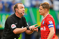 Referee Carl Boyeson has woeds with Lee Martin of Gillingham during Portsmouth vs Gillingham, Sky Bet EFL League 1 Football at Fratton Park on 10th March 2018