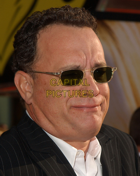 TOM HANKS.The New Line Cinema's World Premiere of Raise Your Voice held at The Loews Universal City 18 Theatres in Universal City, California .October 3, 2004.headshot, portrait, sunglasses, shades, funny face.www.capitalpictures.com.sales@captialpictures.com.Copyright 2004 by Debbie VanStory
