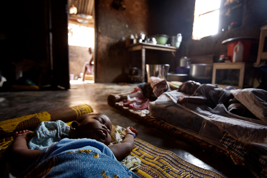"""two children, born by  former """"trokosi"""" religious slaves,  and still connected to the shrine sleep just outside the shrine  in Kilkor, in the Volta region, Ghana on Friday March 09 2007.."""