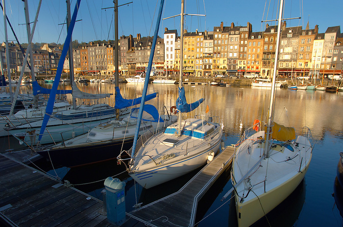 harbour scene with yaughts and harbour restaurants. Honfleur, Normandy, France.