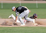 Watertown, CT- 26 June 2017-062617CM05-  Waterbury's Jalen Monroe safely gets back to second base during their American Legion matchup against Oakville on Monday.  Trying to make the tag is Oakville's Justin Guerrera.    Christopher Massa Republican-American