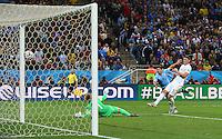Luis Suarez of Uruguay scores a goal past Joe Hart of England to make the score 2-1