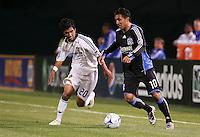 A.J. DeLaGarza (20) and Arturo Alvarez (10) battle for the ball. San Jose Earthquakes tied Los Angeles Galaxy 1-1 at the McAfee Colisum in Oakland, California on April 18, 2009.