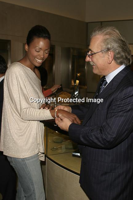 Aisha Tyler &amp;Jennifer Love<br />ARIEL'S HEART OF HOPE <br />Neiman Marcus<br />Beverly Hills, CA, USA<br />Wednesday, December 10, 2003   <br />Photo By Celebrityvibe.com/Photovibe.com