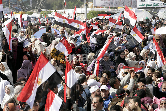 Anti-government protesters take part in demonstrations in Tahrir Square in downtown Cairo, Egypt, Tuesday, Feb. 8, 2011. Protesters appear to have settled in for a long standoff, turning Tahrir Square into a makeshift village with tens of thousands coming every day, with some sleeping in tents made of blankets and plastic sheeting..  Photo by Karam Nasser