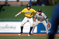 Michigan Wolverines shortstop Jack Blomgren (18) leads off first base in front of first baseman John McKenna (21) during a game against Army West Point on February 17, 2018 at Tradition Field in St. Lucie, Florida.  Army defeated Michigan 4-3.  (Mike Janes/Four Seam Images)