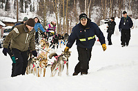Checkpoint volunteers help park Dee Dee Jonrowe's team at Ruby on Friday during the 2008 Iditarod