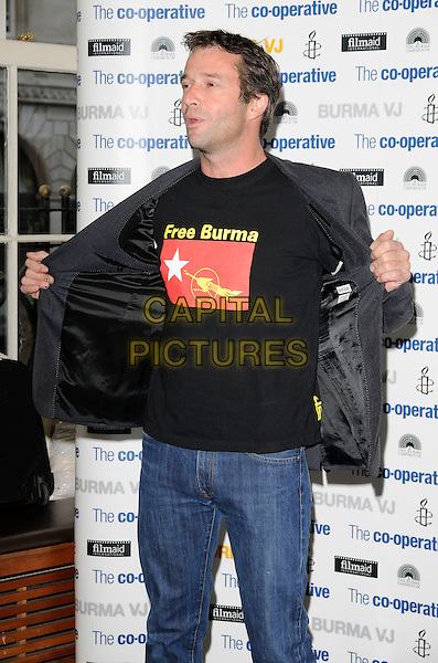"JAMES PUREFOY .Attending the ""Burma VJ"" UK Film Premiere, BAFTA HQ, Piccadilly, London, England, UK, July 14th 2009..half length Free burma slogan t-shirt blazer jacket black grey gray .CAP/CAN.©Can Nguyen/Capital Pictures"