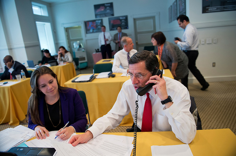 UNITED STATES - JULY 18: Sen. John Barrasso, R-Wyo., calls donors  during a fund drive at the National Republican Senatorial Committee.(Photo By Tom Williams/CQ Roll Call)