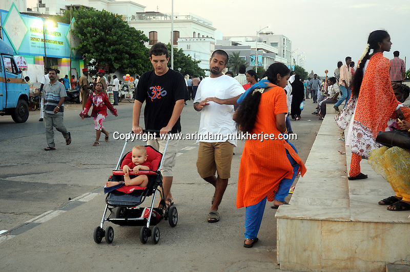 Foreign residents and Indian tourists at the beach road in Pondicherry.Arindam Mukherjee/Sipa