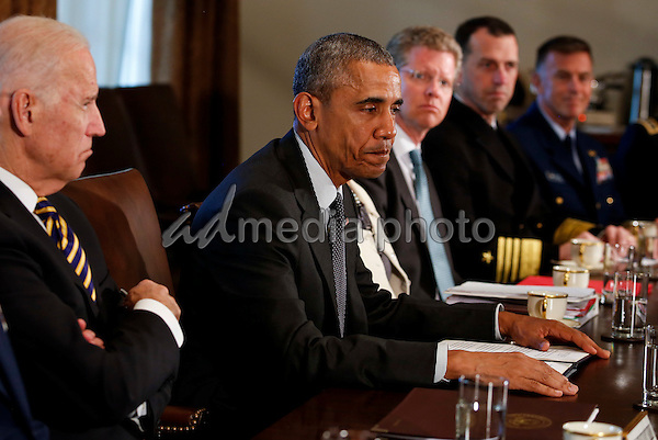 United States President Barack Obama meets with Combatant Commanders and Joint Chiefs of Staff with Vice President Joe Biden (L) in the Cabinet Room of the White House, in Washington, DC, April 5, 2016. Photo Credit: Aude Guerrucci/CNP/AdMedia